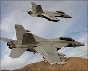 "A pair of Boeing EA-18G Growlers, XE 573 166857 and XE 571 166855 of the VX-9 ""Vampires"" bank over the desert."