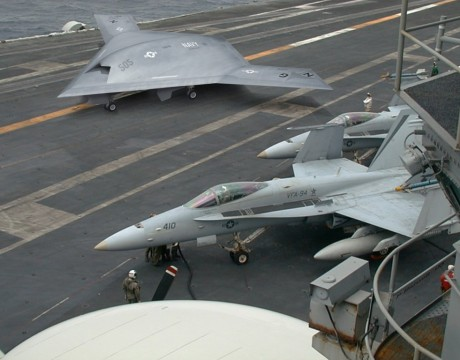 Conceptual rendering of an X-47B unmanned attack plane on an aircraft carrier.
