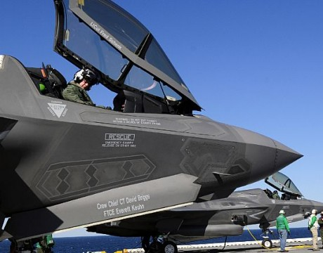 two Marine Corps variants of the F-35B Lighting II Joint Strike Fighter, are secured on the flight deck of the amphibious assault ship USS Wasp (LHD 1) during sea trials. The F-35B is capable of short takeoffs and vertical landings for use on amphibious ships or expeditionary airfields to provide air power to the Marine Air Ground Task Force. (U.S. Navy photo)