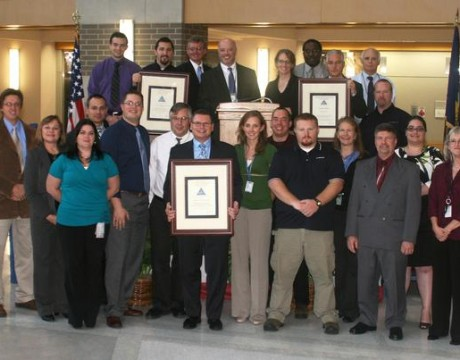 A few of the team members representing the Aircraft Launch and Recovery Equipment - program's Electromagnetic Aircraft Launch System, F-35C Joint Strike Fighter Jet Blast Deflector and Compact Swaging Machine teams who received 2011 Naval Air Warfare Center Aircraft Division Commander's and Innovation awards, which were distributed on Dec. 7. (U.S. Navy photo)