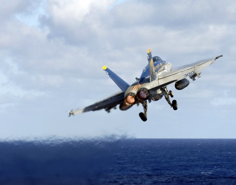 F/A-18C Hornet launches from the flight deck aboard USS Kitty Hawk over the China Sea