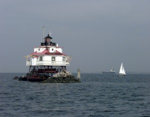 A sailboat cruises by Thomas Point Light in the Chesapeake Bay. USCG photo by Pete Milnes