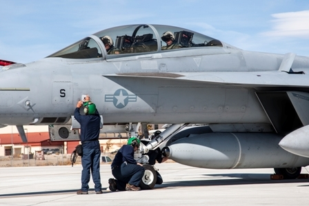 The crew of the F/A-18 Super Hornet carrying the Navy's Infrared Search and Track (IRST), a long-wave infrared sensor system that searches for and detects heat sources within its field of regard, inspects the aircraft Feb. 11 before the maiden flight with the pod at Edwards Air Force Base, Calif. (Photo courtesy of Lockheed Martin)